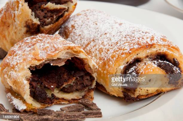 Powdered sugar on chocolate croissants