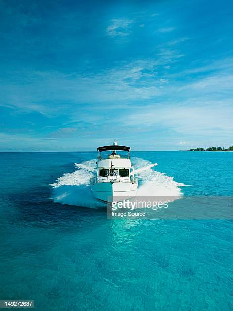 power boat, front view - yacht stock pictures, royalty-free photos & images