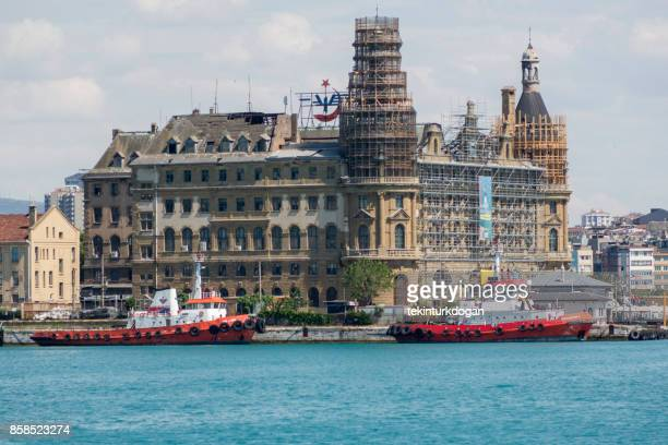 power boat is in front of old haydarpasa train station at istanbul - haydarpasa stock photos and pictures