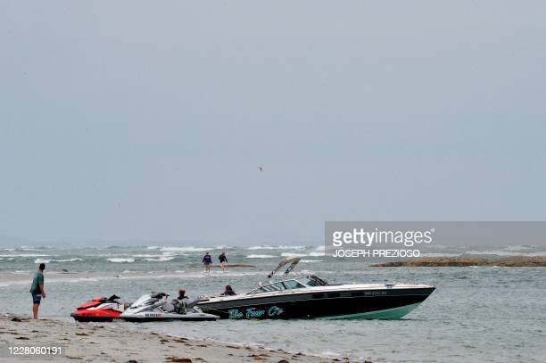A power boat is tied to two jet skis at Wingaersheek Beach in Gloucester Massachusetts on August 15 2020 Over the past summer weekends hundreds of...