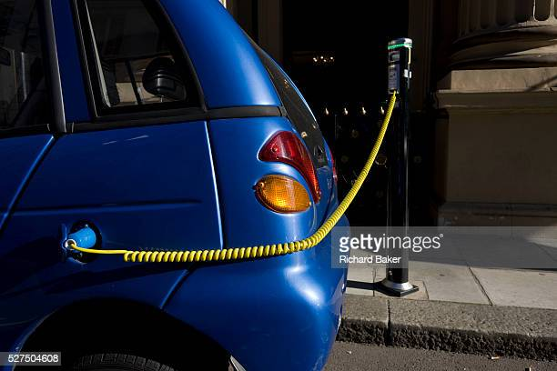A power cable plugs into the place of a petrol cap while recharging GWiz car in central London A power cable plugs into the place of a petrol cap...