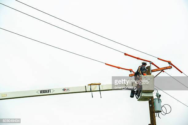 Power crews replace old telephone pole