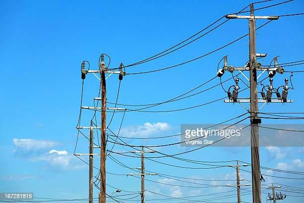 Power electricity poles against a blue sky