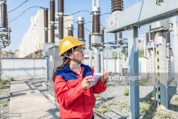 power engineer checking electrical equipment at substation - power occupation stock pictures, royalty-free photos & images