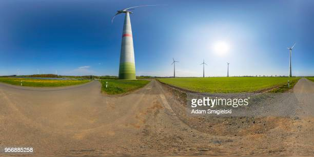 power generating wind turbines and the solar panels in the countryside (360-degree panorama) - 360 degree view stock pictures, royalty-free photos & images