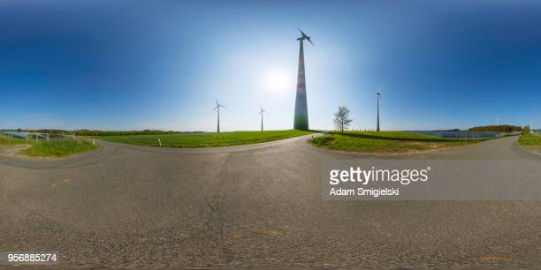 power generating wind turbines and the solar panels in the countryside (360-degree panorama)