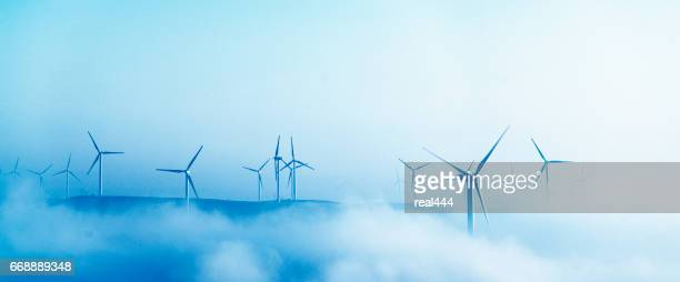 power generating windmills - windmills stock photos and pictures