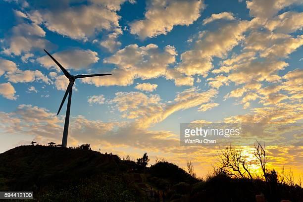 Power generation wind turbine at sunset