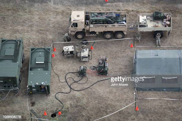 Power generators provide electricity to a military camp under construction at the USMexico border on November 7 2018 in Donna Texas The forward...