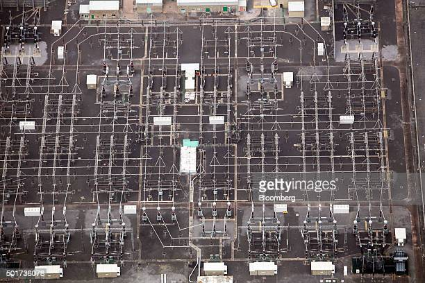 A power grid stands at Hinkley Point B nuclear power station operated by Electricite de France SA's near Bridgwater UK on Thursday Dec 17 2015...