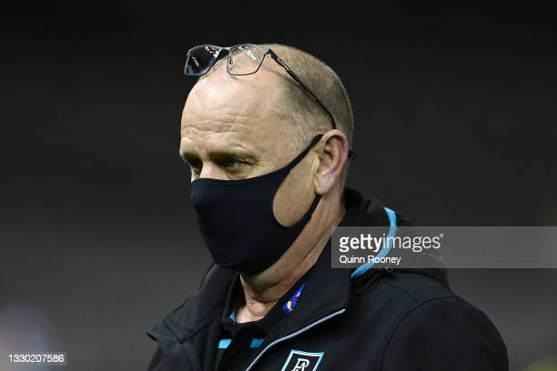 Power head coach Ken Hinkley walks away from talking to his players during the round 19 AFL match between Port Adelaide Power and Collingwood Magpies...