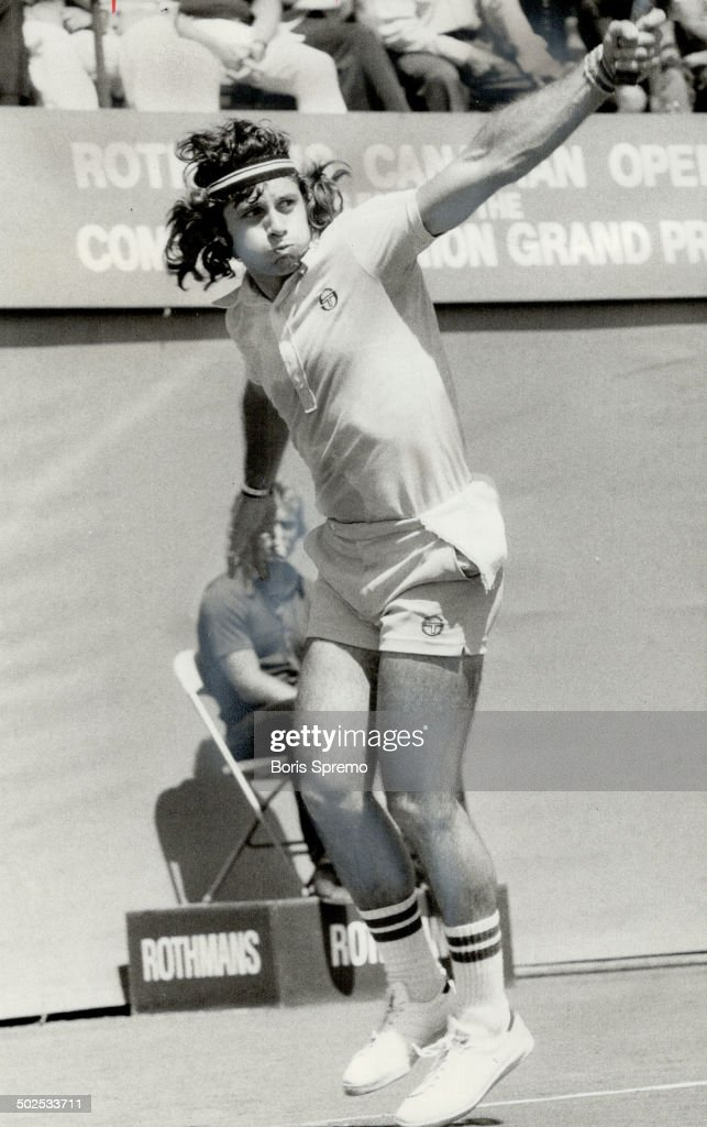 Power Hitting: New Canadian Open tennis champion; Guillermo Vilas of Argentina; strokes backhand ret : News Photo