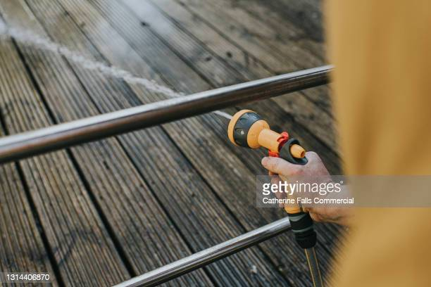 power hosing wooden decking - clean stock pictures, royalty-free photos & images