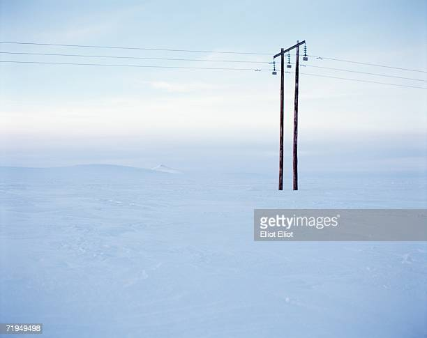 A power line in a winter landscape.