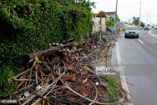 Power line poles and lines downed by the passing of Hurricane Maria lie on a sidewalk in San Juan Puerto Rico on November 7 2017 The Center for...