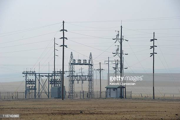 Power lines are seen as an outofcontrol wildfire threatens the electrical grid in the area on June 9 2011 in Springerville Arizona The Wallow Fire is...