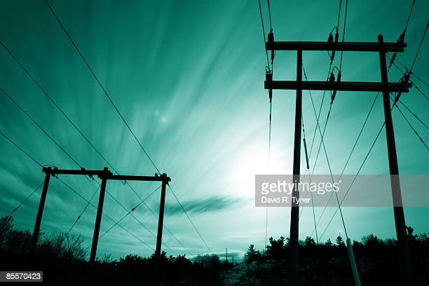 power lines at night with moon and moving cloud - kingston ontario stock photos and pictures