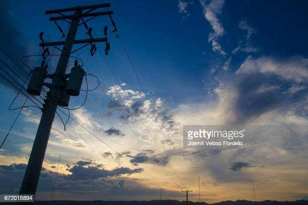 power lines at sunset in cebu city, philippines - joemill flordelis stock pictures, royalty-free photos & images