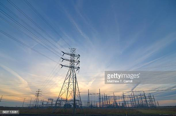 power lines at sunset - power line stock pictures, royalty-free photos & images