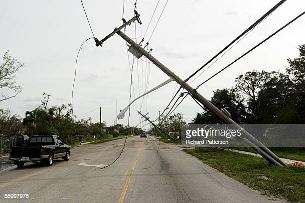 Power lines bend in the wake of Hurricane Wilma on October 24 2005 in Ft Lauderdale Florida Hurricane Wilma hit the western coast of Florida as a...