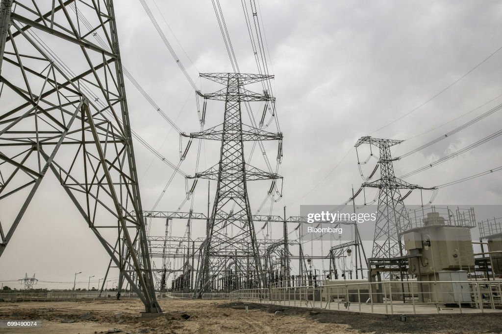 Power lines hang from transmission pylons at the Sahiwal coal power plant owned by China`s stateowned Huaneng Shandong Rui Group in Sahiwal Punjab...