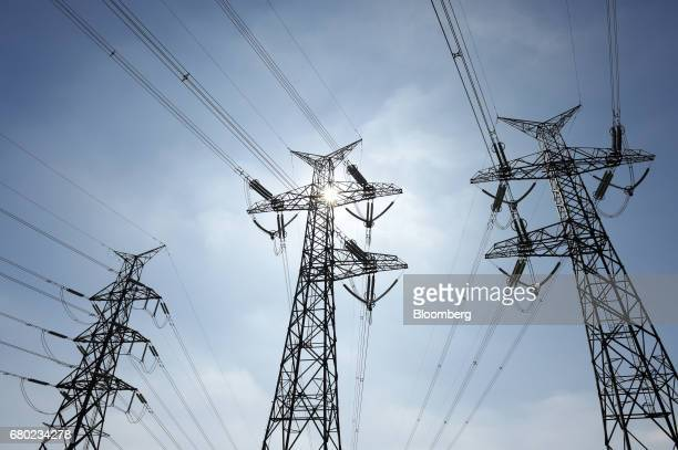 Power lines hang from transmission pylons in the outer suburbs of Melbourne Australia on Friday April 28 2017 Australia has some of the world's...