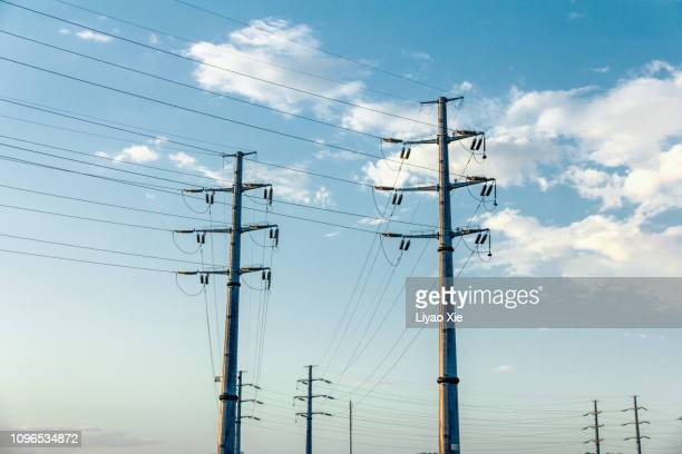 power lines in the suburbs - power line stock pictures, royalty-free photos & images