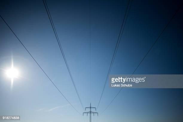 Power lines lead to the RWE Kraftwerk Westfalen coalfired power plant on February 14 2018 near Hamm Germany The plant uses bituminous coal and has a...