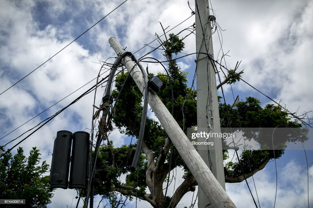 Power lines on a utility pole are seen destroyed from Hurricane Maria in the town of Limones, Yabucoa, Puerto Rico, on Friday, May 18, 2018. The bankrupt U.S. commonwealth's investment bankers last week started sounding out suitors for the eight-decade-old monopoly known asPrepa, whose rickety infrastructure was almost erased by Hurricane Maria in 2017. The halting efforts to repair the damage and improve the antiquated grid have been the central obstacle in recovery. Photographer: Xavier Garcia/Bloomberg via Getty Images