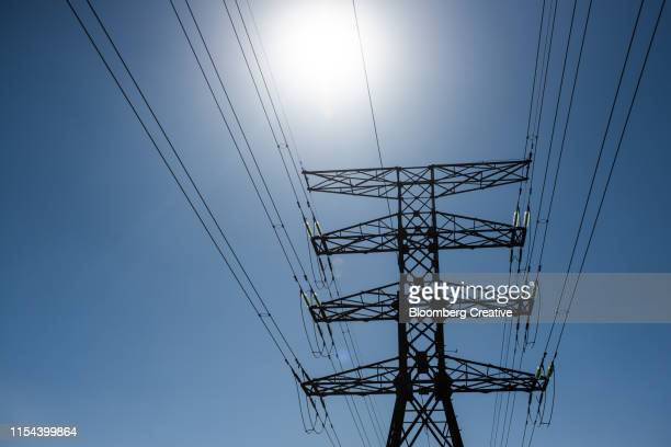 power lines on an electricity pylon - blackout stock pictures, royalty-free photos & images
