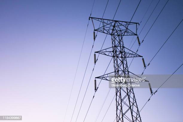 power lines on an electricity pylon - blackout picture stock pictures, royalty-free photos & images