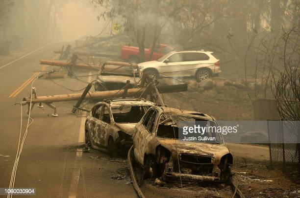 Power lines rest on cars that were burned by the Camp Fire on November 10, 2018 in Paradise, California. Fueled by high winds and low humidity, the...