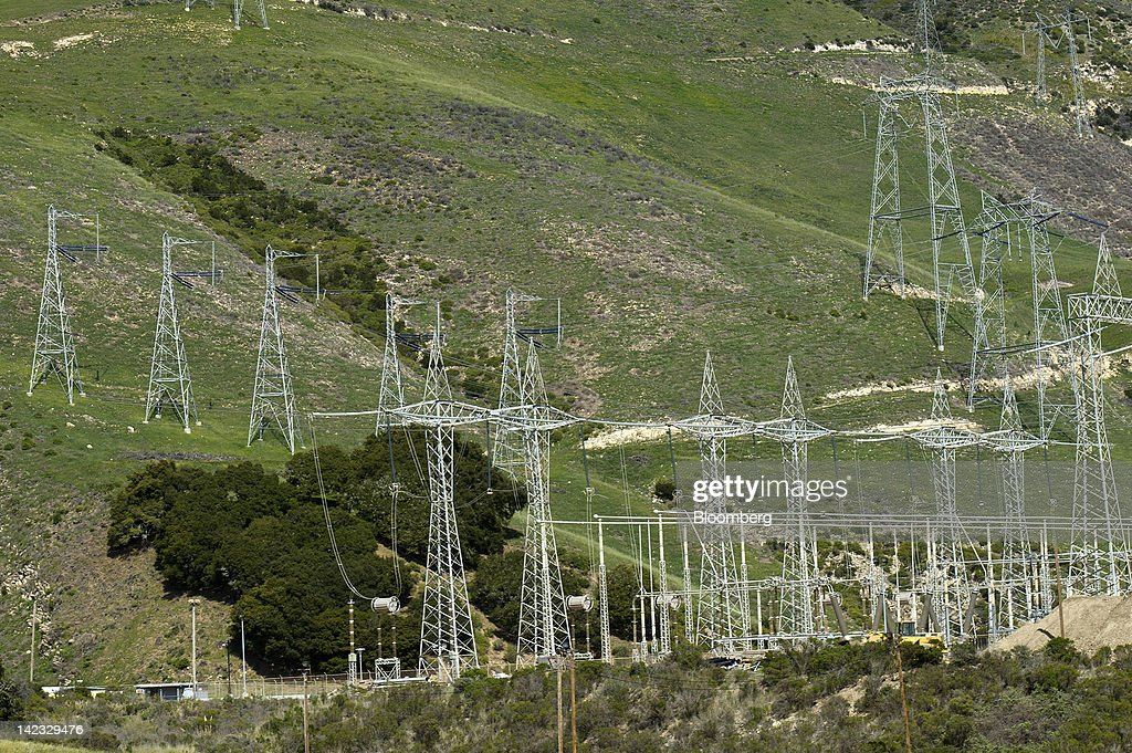 Power lines stand on the hillsides outside of the Pacific Gas and Electric Co. (PG&E) Diablo Canyon nuclear power plant in Avila Beach, California, U.S., on Friday, March 30, 2012. U.S. nuclear-power production fell 2.1 percent to the lowest level in more than 10 months as four reactors shut in Pennsylvania, Florida, Alabama and Texas. Photographer: David Paul Morris/Bloomberg via Getty Images