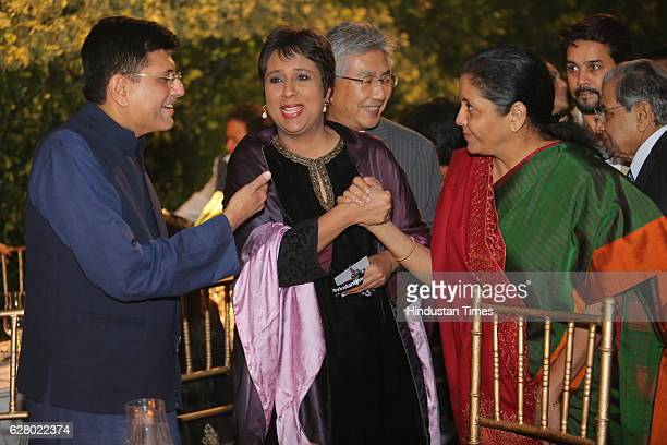 Power Minister Piyush Goel with journalist Barkha Dutt and Commerce Industry minister Nirmala Sitharaman during HT Leadership Summit gala dinner in...