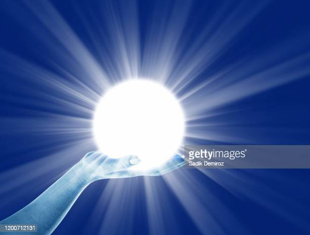 power of lights in palm of hand - knowledge is power stock pictures, royalty-free photos & images