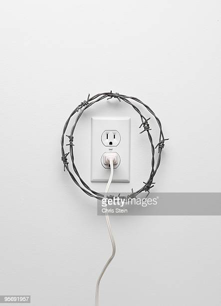 power outlet safety - barbed wire stock pictures, royalty-free photos & images