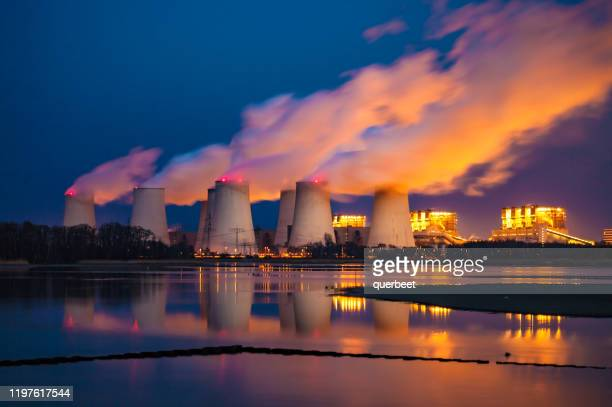 power plant at sunset - coal fired power station stock pictures, royalty-free photos & images