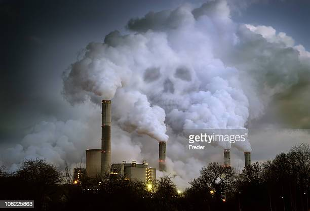 power plant billowing smoke in shape of skull - carbon dioxide stock photos and pictures