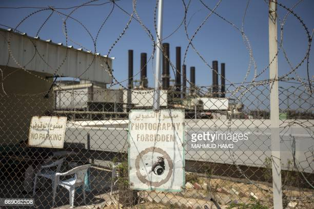 A power plant in Gaza City is pictured from behind a fence on April 16 2017 The Gaza Strip's only functioning power plant was out of action after...