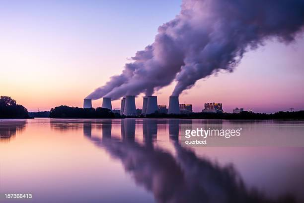 power plant in the sunrise - carbon dioxide stock photos and pictures