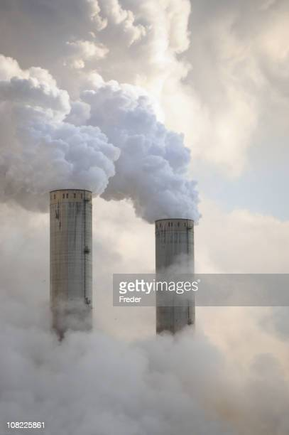 power plant towers billowing smoke - coal fired power station stock photos and pictures