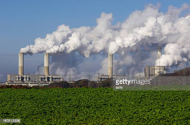 power plant with pollution - carbon dioxide stock photos and pictures