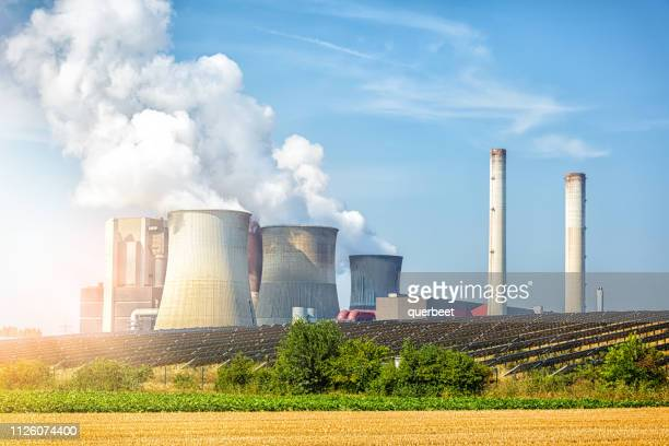 power plant with solar panels - coal fired power station stock photos and pictures