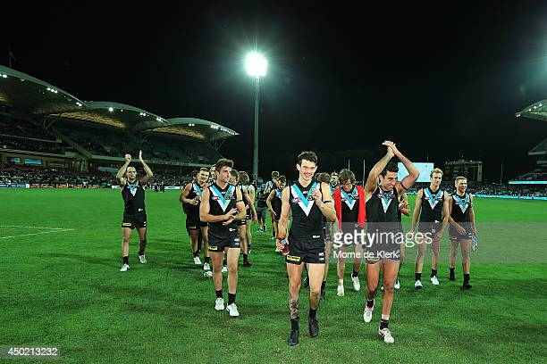 Power players celebrate after the round 12 AFL match between the Port Adelaide Power and the St Kilda Saints at Adelaide Oval on June 7, 2014 in...