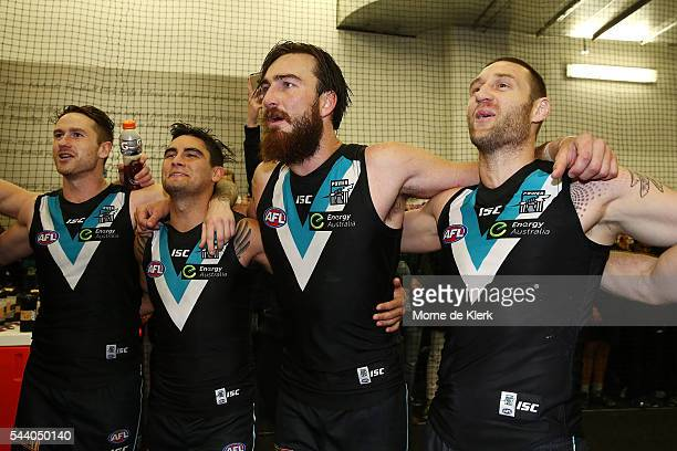Power players celebrate after winning the round 15 AFL match between the Port Adelaide Power and the Richmond Tigers at Adelaide Oval on July 1 2016...