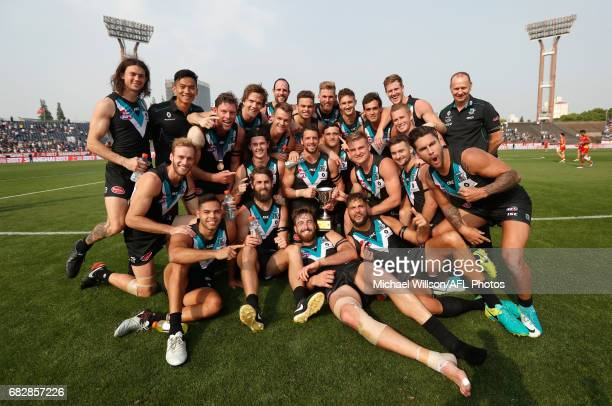 Power players celebrate during the 2017 AFL round 08 match between the Gold Coast Suns and Port Adelaide Power at Jiangwan Sports Stadium on May 14...