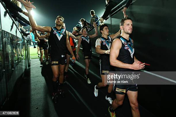 Power players come from the field after winnning the round four AFL match between the Port Adelaide Power and the Hawthorn Hawks at Adelaide Oval on...