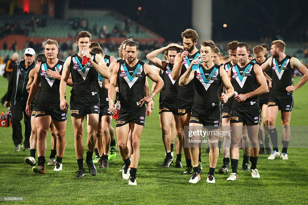Power players leave the field after losing the round 16 AFL match between the Port Adelaide Power and the Hawthorn Hawks at Adelaide Oval on July 7, 2016 in Adelaide, Australia.