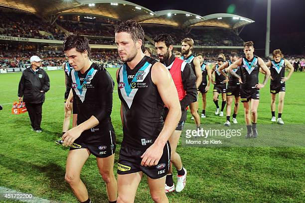 Power players leave the field after the round 16 AFL match between the Port Adelaide Power and the Essendon Bombers at Adelaide Oval on July 5 2014...