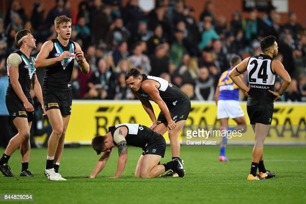 Power players look on dejected after the AFL First Elimination Final match between Port Adelaide Power and West Coast Eagles at Adelaide Oval on...